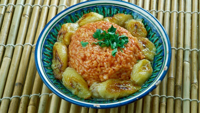 Red stew is the base for jollof rice, shown here with fried plantains.