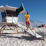 Pensacola Beach Lifeguard, Chris Wilson, sets-up a lifeguard tower at Casino Beach Tuesday morning. Beginning today, March 1, the beach public safety begin manning the towers daily from through the summer.