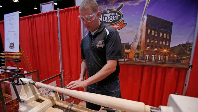 P.J. Shelley, of the Louisville Slugger Museum & Factory, turns a bat at Redsfest in 2013.