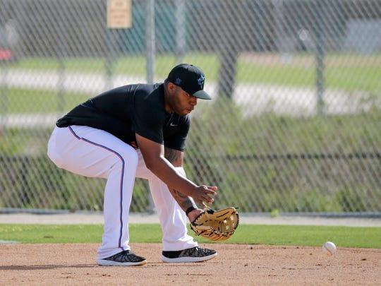 Miami Marlins infielder Jesus Aguilar runs a drill at spring training baseball camp in Jupiter, Fla., Wednesday, Feb. 12, 2020. (David Santiago/Miami Herald via AP)