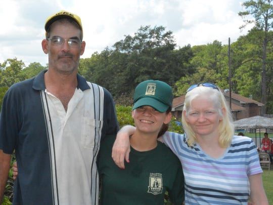 Youth Challenge Program Cadet Destiny Lackey poses with her parents, Richard and Angel Lackey, on Family Day at Camp Beauregard.