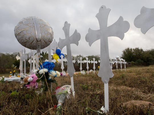 Crosses stand in a field in Sutherland Springs, Texas to honor 26 people killed at First Baptist Church on Nov. 5, 2017. Pastor Frank Pomeroy's 14-year-old daughter, Annabelle, was among those killed, along with seven other children.