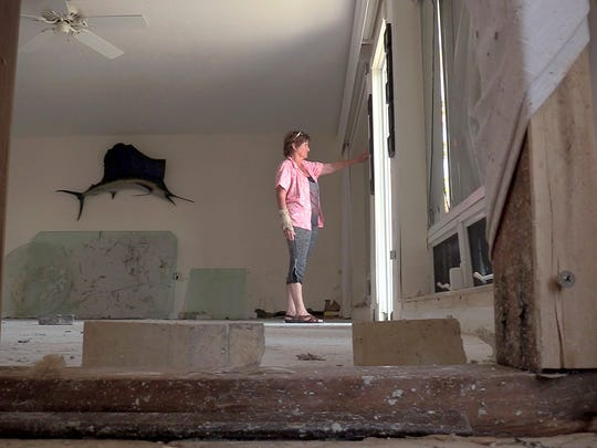 09/18/17-Marathon, Florida—Peggy Calkins surveys her empty home that was left flooded after Hurricane Irma hit the area destroying or damaging many of the homes in the community. Even though most of the contents of her home were destroyed, miraculously her beloved dishes made it.MANDATORY CREDIT - Kelly Jordan, USA TODAY