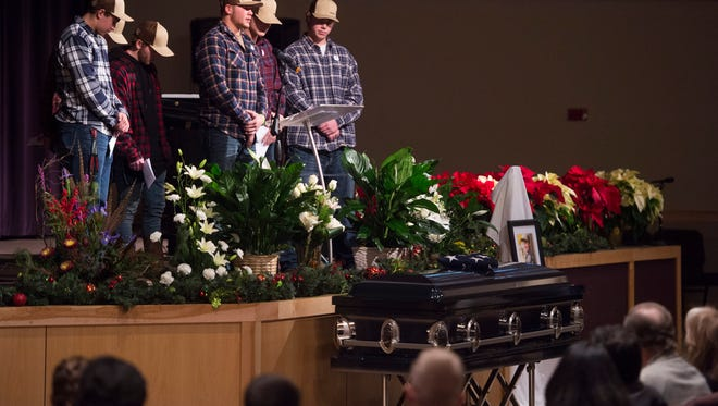 Friends of Jack Headley stand over his casket to share memories of the Windsor High School student during his funeral at Timberline Church in Fort Collins on Tuesday, Dec. 20, 2016. Headley's death is the latest in a string of tragedies that have affected the Windsor community.