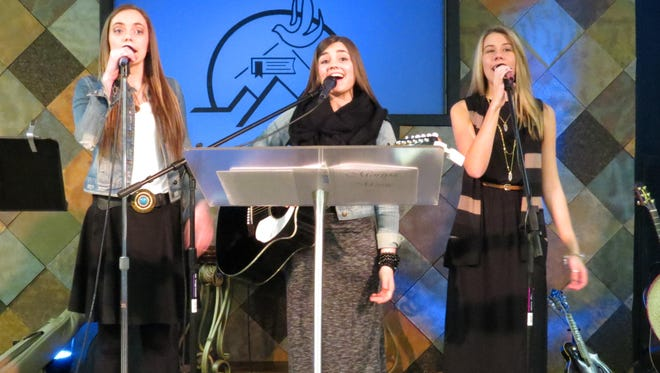 """Local high school students Whitney Robertson (left), Jordan McCorvey (middle) and Emily Gunter (left) have sung together longer than they can remember. Last year, they officially called their group """"Moriya"""" and since have performed at school, churches, retreats, community events, Tamp & Grind Coffee Shop and at the statewide Youth Evangelism Conference at the Cajundome in Lafayette for about 7,000 people."""