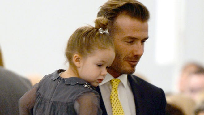 David Beckham with his daughter Harper Beckham. (Photo by Getty Images)
