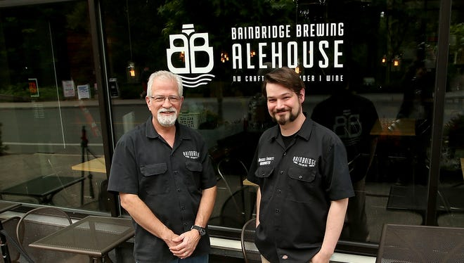 Chuck and Russell Everett at their new Bainbridge Brewing Alehouse in downtown Winslow on Thursday, June 7, 2018.