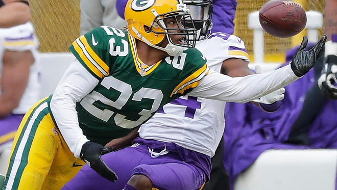 Green Bay Packers cornerback Damarious Randall (23) breaks up a pass intended for wide receiver Cordarrelle Patterson (84) against the Minnesota Vikings at Lambeau Field on Dec. 24, 2016.