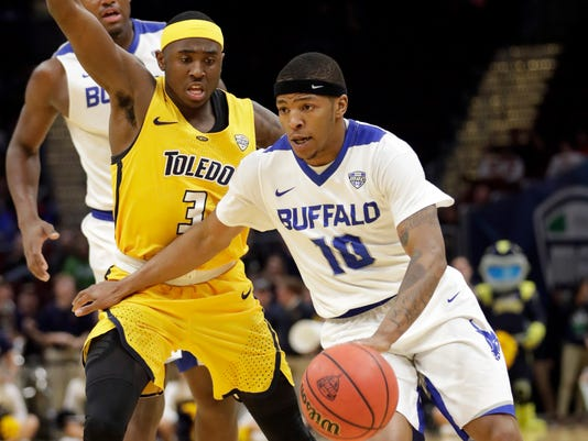 FILE - In this Saturday, March 10, 2018, file photo, Buffalo's Wes Clark (10) drives past Toledo's Marreon Jackson (3) during the second half of an NCAA college basketball championship game of the Mid-American Conference tournament, in Cleveland. Clark went from his college career being stuck in limbo over a two-year span to helping the University at Buffalo win the Mid-American Conference championship and secure its third NCAA Tournament berth in four years. (AP Photo/Tony Dejak, File)