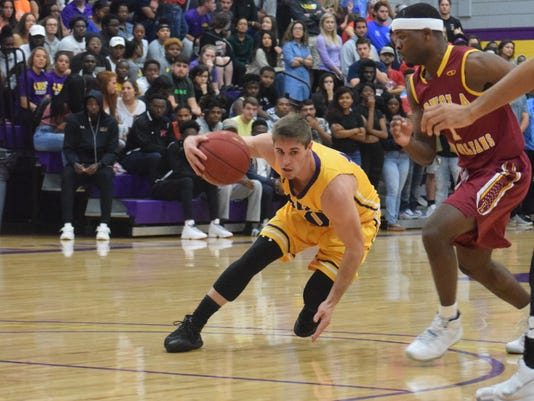LSUA's Joseph Feraci (10, left) drives against Loyola University New Orleans defenders Wednesday, Nov. 15, 2017 at the Fort.