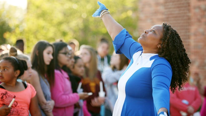 Creative Blessings Dancers perform at a candlelight vigil held for Sandra and Haylee Martin at Kate Collins Middle School in Waynesboro on Sunday, April 26, 2015, to honor Sandra and Haylee Martin, the mother and daughter who died in an accident on April 20 on U.S. 250 in Staunton.