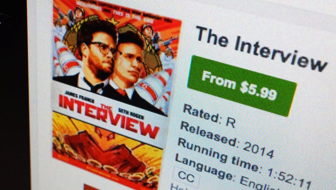 """FILE-In this Wednesday, Dec. 24, 2014 file photo, a computer screen shows Sony Pictures' film, """"The Interview"""" available for rental on YouTube Movies, in Los Angeles. Sony appears to have a win-win with """"The Interview."""" Not only did the studio score a moral victory by releasing the film in the face of hacker threats, the movie made at least $15 million from more than 2 million digital rentals and purchases in its first four days. (AP Photo/Richard Vogel, File) ORG XMIT: CAET237"""