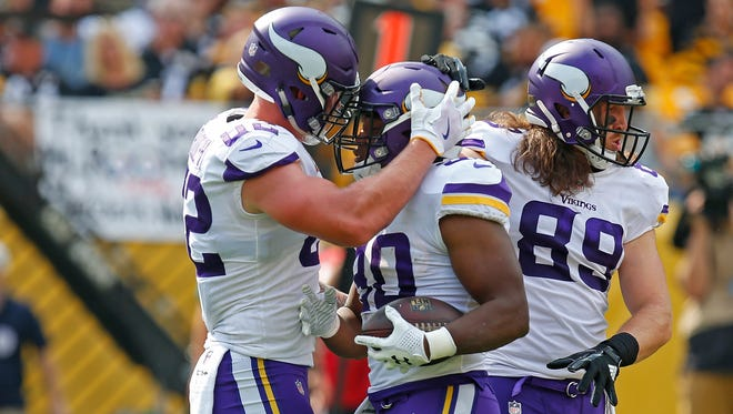 PITTSBURGH, PA - SEPTEMBER 17: C.J. Ham #30 of the Minnesota Vikings celebrates with Kyle Rudolph #82 after rushing for a 1-yard touchdown in the third quarter during the game against the Pittsburgh Steelers at Heinz Field on September 17, 2017 in Pittsburgh, Pennsylvania. (Photo by Justin K. Aller/Getty Images)