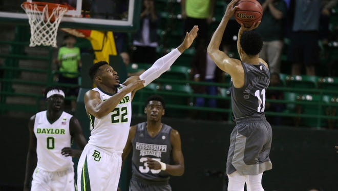 Mississippi State guard Quinndary Weatherspoon, right, scores the game winning shot over Baylor guard King McClure, left, during the first second half of an NCAA college basketball game in the second round of the NIT tournament, Sunday, March 18, 2018, in Waco, Texas. (Rod Aydelotte/Waco Tribune-Herald via AP)