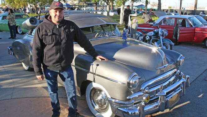 Andy Braunstein stands with his 1950 Chevy Styleline at the Mooneyes event at  Irwindale Raceway in Irwindale, Calif.