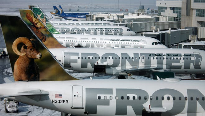 Frontier Airlines jets sit at gates in 2010 at Denver International Airport.