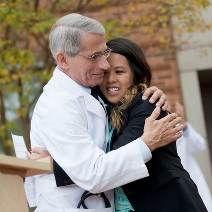 Nina Pham is hugged by Dr. Anthony Fauci, Director