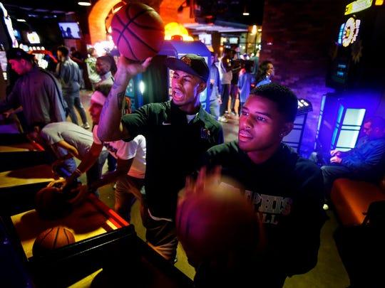 University of Memphis teammates Tye Northern (middle)