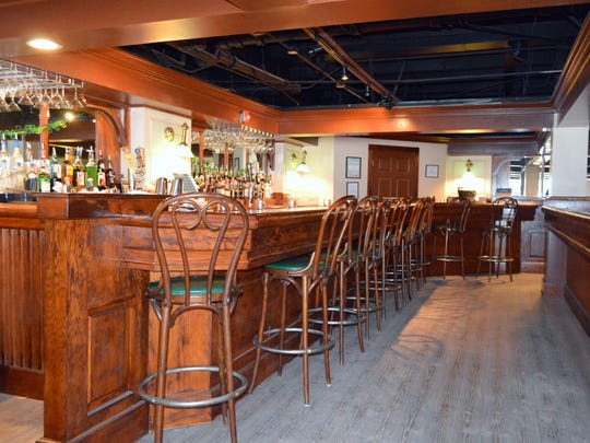 A completely refinished bar at The Highlander Public