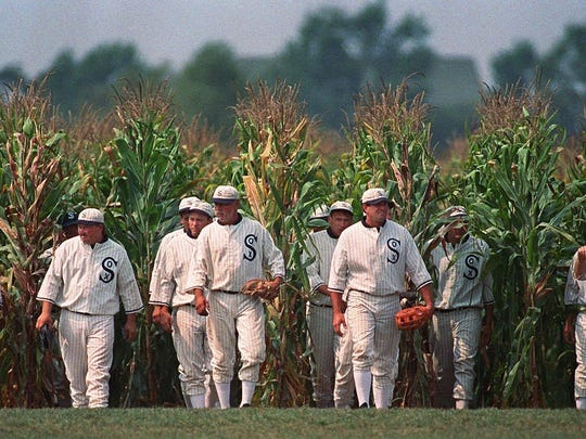 """Ghost Players emerge from the cornfield at the """"Field of Dreams"""" movie site in Dyersville, Iowa."""