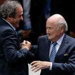 Re-elected FIFA president Sepp Blatter, right, is congratulated by FIFA vice president and UEFA president Michel Platini after his speech during the 65th FIFA Congress Friday in Zurich, Switzerland. Blatter has been re-elected as FIFA president for a fifth term, chosen to lead world soccer despite separate U.S. and Swiss criminal investigations into corruption.