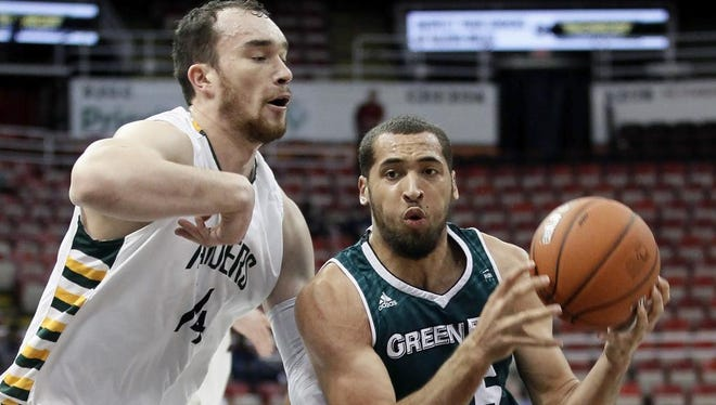 UWGB's Kenneth Lowe, right, drives to the basket against Wright State's Michael Karena during the first half of the Horizon League championship game Tuesday in Detroit.