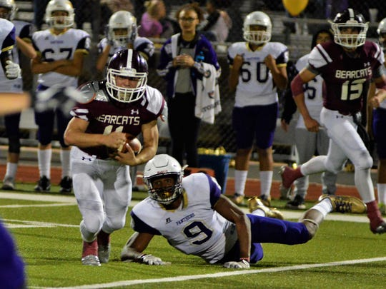 De Leon's Anthony Rangel breaks a tackle during the first half of Friday's 47-7 loss to Mart in Whitney.