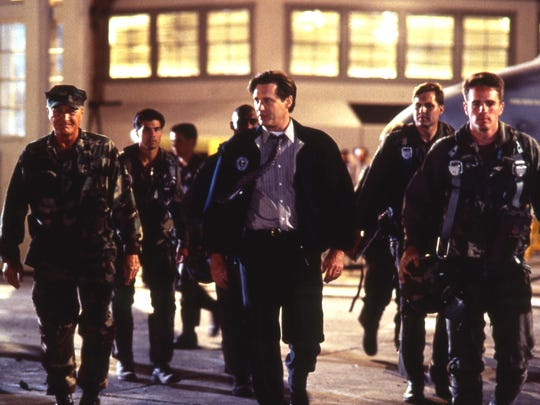 President Whitmore (center, Bill Pullman) leads his