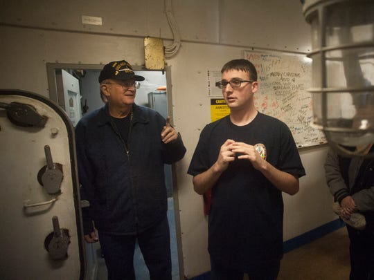 Hunter Hiros, a 20-year-old student at The Bancroft School, interacts with Navy veteran Ed Hamilton near their work room inside the Battleship New Jersey.