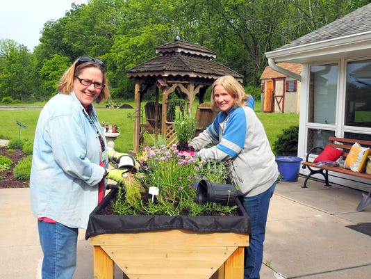 636346905739078662-July-6-article-Pam-Withington-Barbara-Stockl-are-planting-herbs-in-trugs-in-the-Sensory-Garden---Photo-by-Jean-Agostinelli.JPG