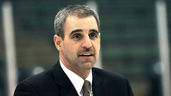 Tom Anastos, the former CCHA commissioner, speaks after being named Michigan State's hockey coach in March 2011.