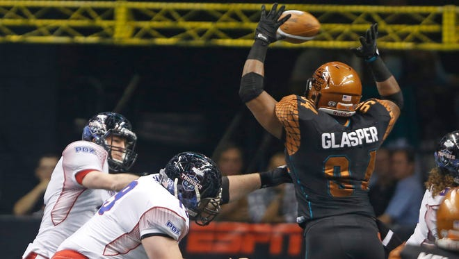 Rattlers' Tyre Glasper (94) knocks a pass incomplete from Thunder's Kyle Rowley (3) at the US Airways Center in Phoenix, AZ on April 18, 2015.