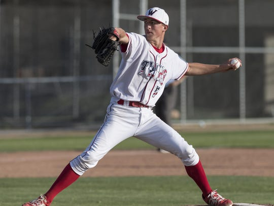 Tulare Western's Wyatt Gilbert pitches against Tulare