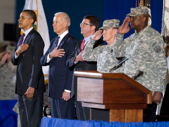 President Barack Obama, from left, Vice President Joe Biden, Deputy Secretary of Defense Ashton Carter, and Chairman of the Joint Chiefs of Staff Martin Dempsey stand for the National Anthem during a ceremony marking the return of Gen. Lloyd Austin, right, at Andrews Air Force Base, Md., on Dec. 20, 2011. The return of Austin, the top U.S. commander in Iraq, his staff, and the U.S. Forces-Iraq command flag, marked the formal end to the U.S. military mission in Iraq.