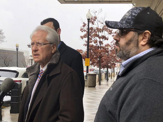 Attorney Larry Klayman, left, talks to the media, as Andrew Stettner, right, stepson of conservative writer Jerome Corsi, looks on, outside the federal courthouse after Stettner testified before a grand jury, Jan. 24, 2019 in Washington.
