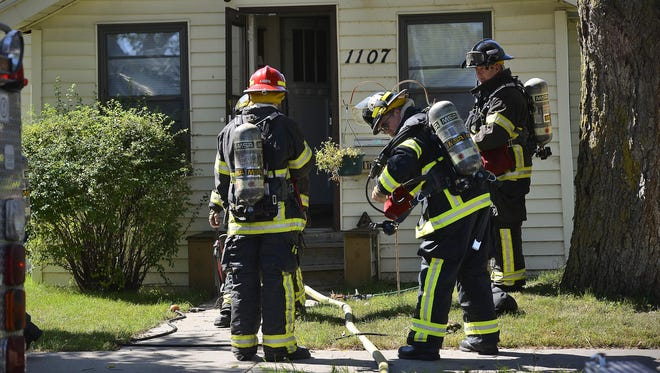 St. Cloud firefighters work at the scene of what was believed to be an electrical fire at 1107-14th Ave. S on Tuesday afternoon. According to Capt. Scot Olson, the fire was extinguished and remained under investigation.