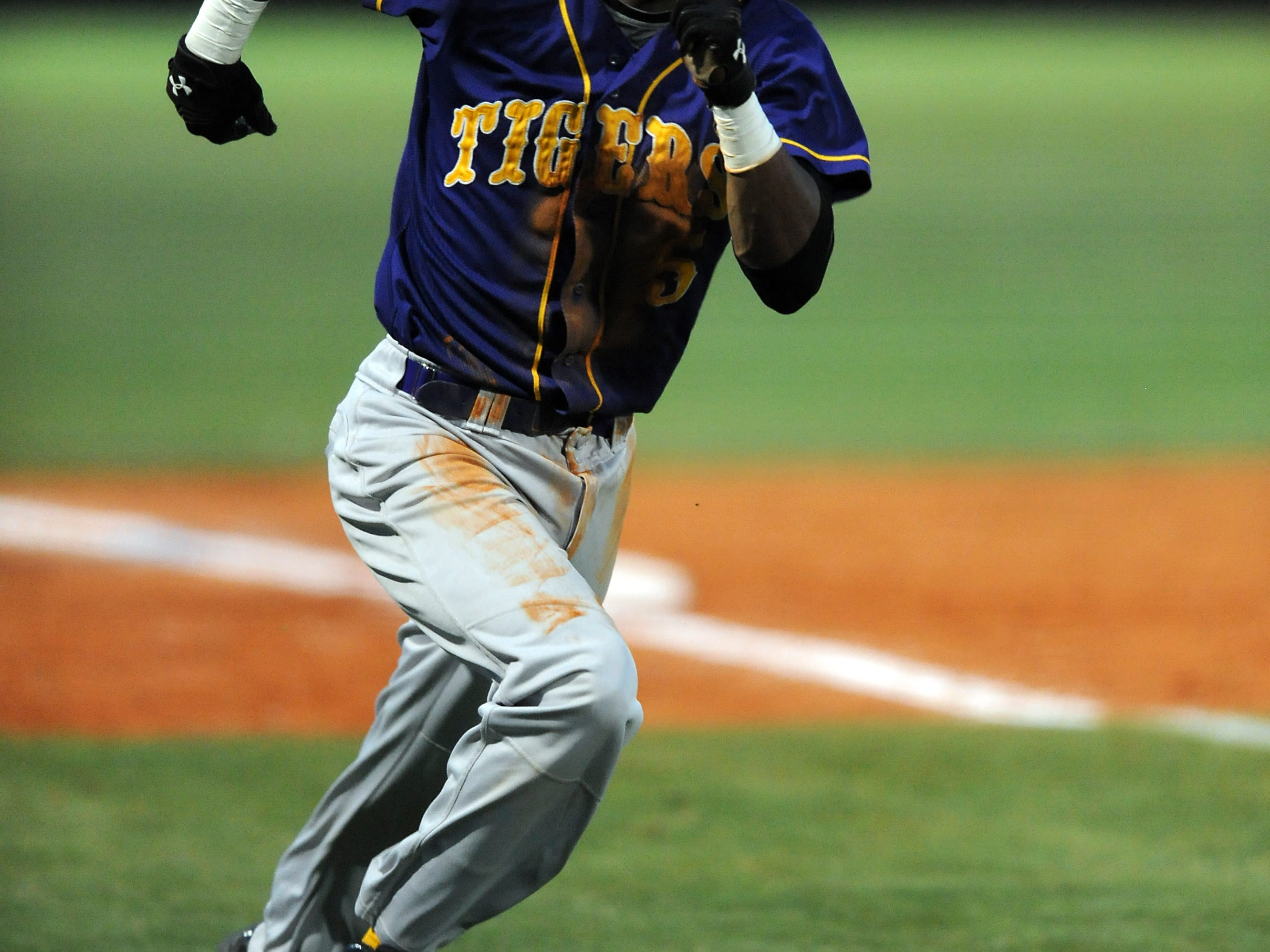 Hattiesburg's Jorronnie Hinton (5) runs home Tuesday during the Tigers' game against Oak Grove at Oak Grove High School.