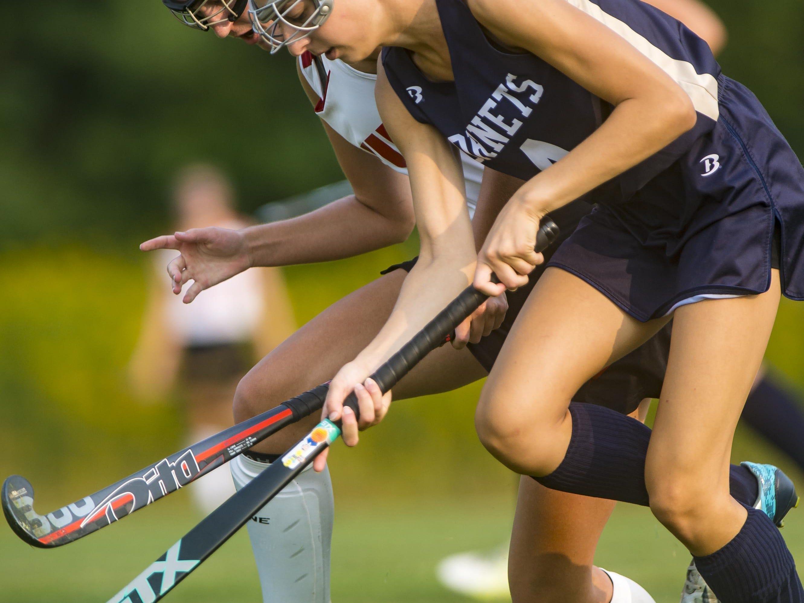CVU's Taya LePrevost, left, shadows Essex's Alicia Russotti in Hinesburg on Wednesday, September 2.