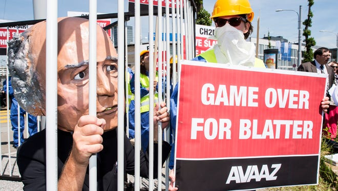 Activists in Zurich protest against FIFA president Sepp Blatter, who is up for re-election on Friday.