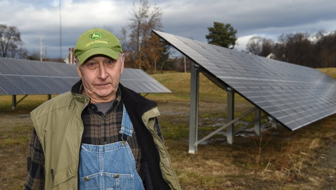William Werba of Milton near the solar panel array he had constructed on his property on Dec. 15, 2015.