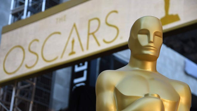 An Oscar statue is seen at the red carpet arrivals area as preparations continue for the 88th annual Academy Awards at Hollywood & Highland Center on Feb. 25, 2016, in Hollywood.