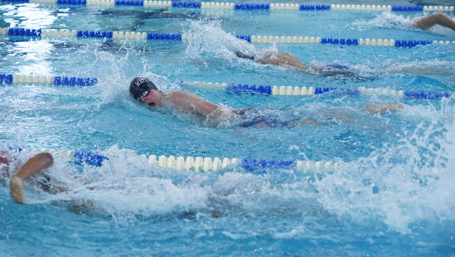 Kyle T. McGregor, center, swims for the Wappingers team in a 200 yard freestyle heat during the Section 1 Conference 3 boys swimming championships at Beacon High School.