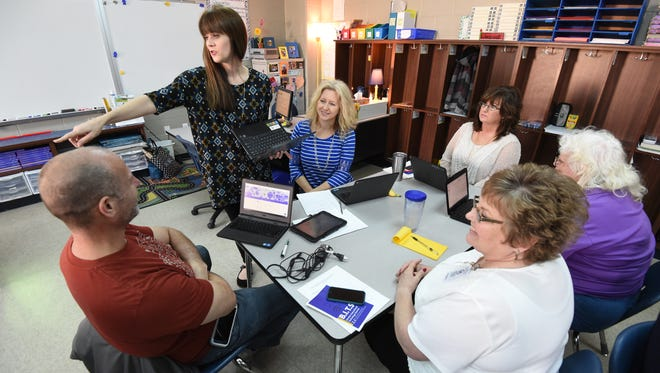 High school English teacher Jennifer Drewry, standing, instructs her fellow Mountain Home teachers Friday on the use of Google Classroom software. Teachers across the district spent Friday learning how to better integrate technology in their classrooms.
