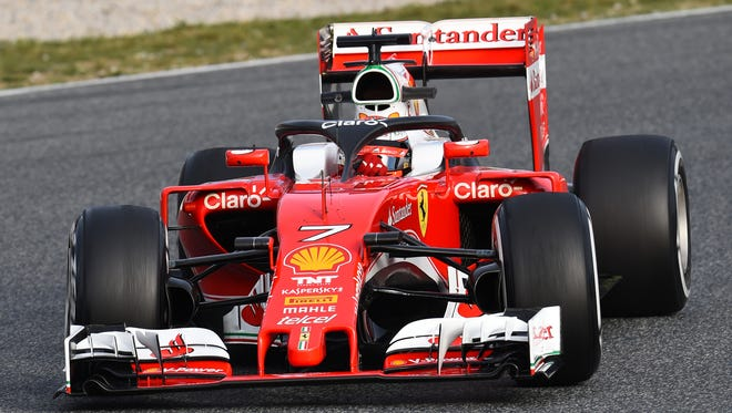 Kimi Raikkonen tests the halo head protection system in Montmelo, Spain, in 2016.