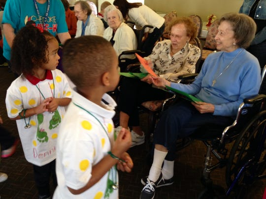 Cherokee Elementary pre-K students deliver handmade Christmas cards to residents at Regency House in Alexandria on Friday. About 70 students handed out cards they made in class and sang Christmas carols.