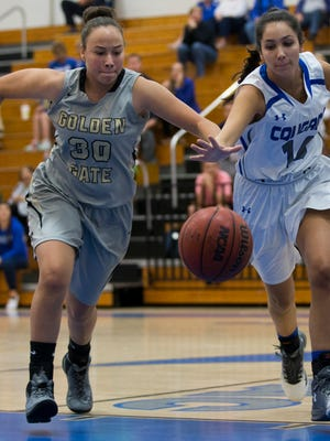 Golden Gate's Melanie Gomez (30) and Barron Collier's Alex LaRosa (14) chase after a loose ball in the first half of action during the Class 7A-District 12 title game Friday, Feb. 3, 2017 in Naples. Barron Collier led 31-13 at the half.