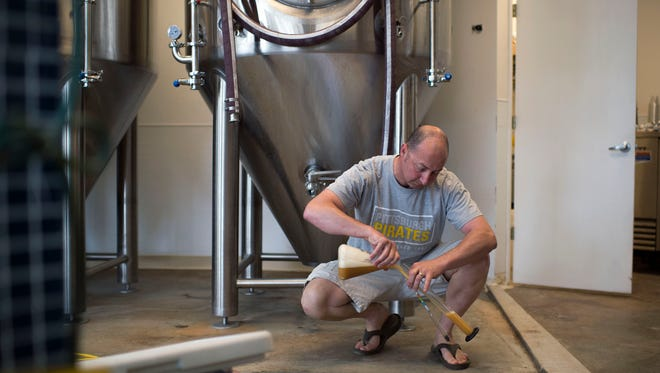 Brewmaster Jason Weissberg works inside Assawoman Bay Brewing Co. on Thursday morning in Ocean City.