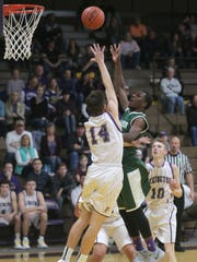 Lexington's Jack Dials contests a shot by Madison's Shamir Brown in Friday's Ohio Cardinal Conference game.