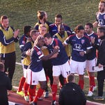 FILE -- Indy Eleven forward Brian Brown (foreground) is swarmed by teammates after he scored the game's first goal early in the game to put the Eleven up 1-0 in the soccer team's 2015 NASL home opener against the New York Cosmos at Michael Carroll Stadium at IUPUI in Indianapolis on Saturday, April 11, 2015.