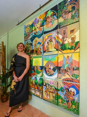 """Artist Dawn Reyes stands beside her artwork entitled """"Our Village"""" (I Sengsong-ta) on display at the Valley of the Latte Visitor Center in Talofofo on Friday, June 29, 2018. This latest artwork is part of Reyes' three part art installment, """"I Estorian Talofofo yan Inalahan,"""" designed to enhance the cultural experience and understanding of ancient Chamorro history specific to the Talofofo site of what is now the Valley of the Latte Adventure Park. Reyes is also one of the co-owners and managing members at the park."""